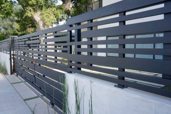 colorbond fencing perth, contactor helping to repair a fence and a gate. In the suburb of Joondalup